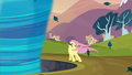 Fluttershy about to get sucked into the tornado S2E22.png