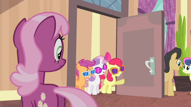 File:CMC with glasses entering the lobby S4E19.png