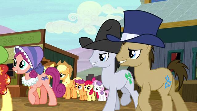 File:Appleloosa ponies follow Sheriff Silverstar S5E6.png