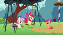 Apple Bloom stands up on the swing S6E4