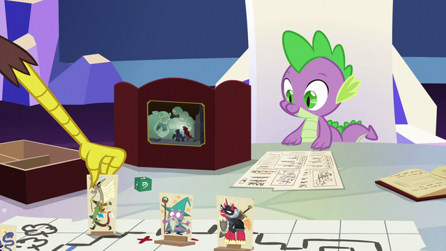 File:Discord sets his character stand on the table S6E17.png