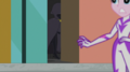 Cloaked figure runs past the Power Ponies set EGS2.png