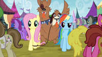 Rainbow and Fluttershy walking through crowd S4E22