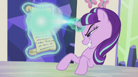 Starlight Glimmer casts magic on scroll S5E25