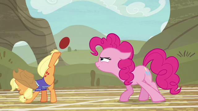 File:Applejack bucking the ball with one hoof S6E18.png