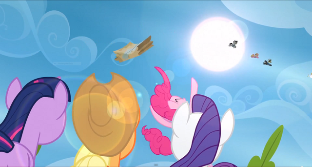 File:Pinkie Pie throws the care package into the air S3E7.png