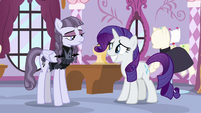 Rarity grinning nervously at Inky Rose S7E9