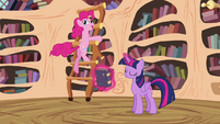 Pinkie Pie spinning around with the ladder in the library S4E18