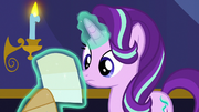 Starlight Glimmer takes letter out of envelope S6E25