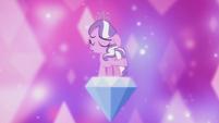 Diamond Tiara singing on top of a large diamond S5E18