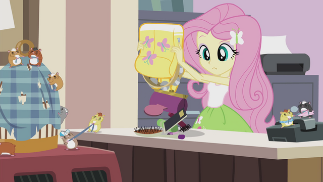 File:Fluttershy emptying the contents of her bag EG2.png