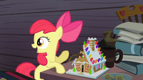 Apple Bloom pointing at the gingerbread house S4E09