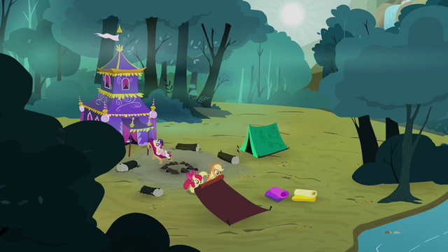 File:Applejack and Apple Bloom rolling their tent S3E06.png