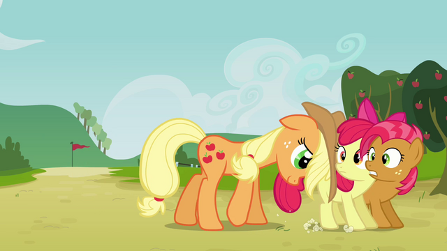 File:Applejack pushing Apple Bloom and Babs S3E08.png