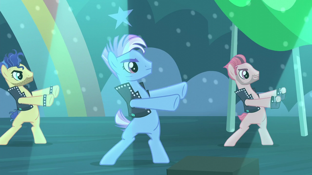 File:Backup dancers on the left moving their arms S5E24.png