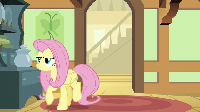 File:Fluttershy turning away from the den door S6E11.png