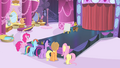Main cast standing in front of a catwalk S4E13.png