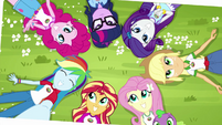 Photograph of Equestria Girls lying in the grass EG4