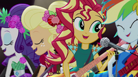 Rarity, AJ, Sunset, and Rainbow singing on stage EG4