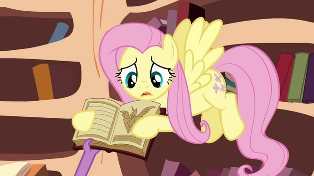File:Spike about to take the book S3E05.png