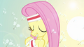 Fluttershy dancing in a field of dandelions S2E22.png
