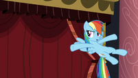 Rainbow in front of curtain S5E15