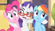 Rarity holding Pinkie and Rainbow S4E08
