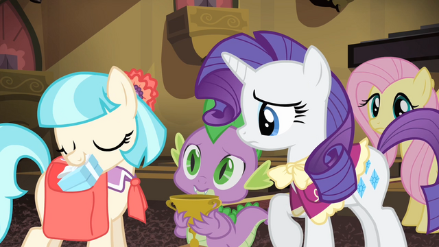 File:Coco pulls a box out of her saddlebag S4E08.png