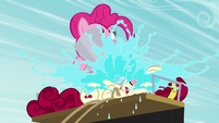 Pinkie throwing a bucket of water at Cherry S5E11