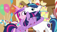 Twilight hugging Shining Armor and Cadance S5E19