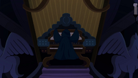 Cloaked figure in front of pipe organ S4E03
