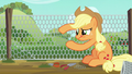 Applejack fixing hole in chain link fence S6E10.png