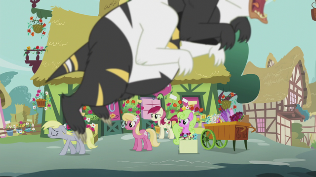 File:The Flower ponies look at Derpy while a bugbear is flying S5E9.png