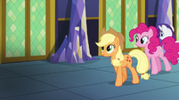 Applejack, Pinkie, and Rarity walking in the castle hallway S5E03