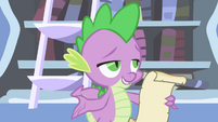 Spike begins reading Celestia's reply S1E01