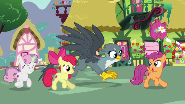 File:Crusaders and Gabby gallop into Ponyville S6E19.png