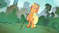 Applejack pulling on a stubborn weed S5E16.png