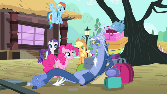 File:Discord lying on a pile of bags S4E11.png