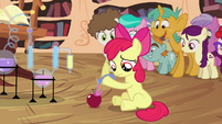 Apple Bloom pouring potion on apple S4E15