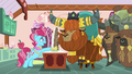 Mrs. Cake gives yaks cake while laughing nervously S5E11.png