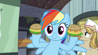 Rainbow holding up oat burgers S4E22
