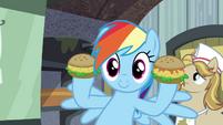 Rainbow holding up oat burgers S4E22