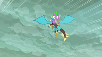 Ember flying with Spike on her back S6E5