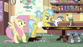 Fluttershy notices Smoky Jr. on runaway chair S7E5.png