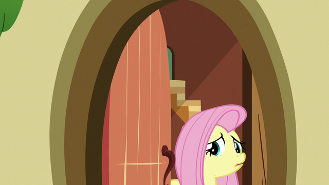 File:Fluttershy nervously answers the door S6E15.png