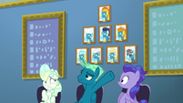 Sky Stinger pointing to wall of Wonderbolts S6E24