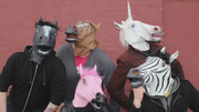 Crew members in horse masks hidden frame S5E9