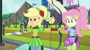 Applejack hands her bow to Fluttershy EG3