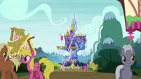 Ponies mingle outside the Castle of Friendship S6E1