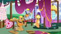 Applejack walking past construction ponies S7E9.png